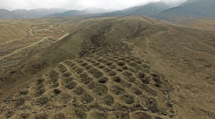 Thousands of aligned holes in Peru's Pisco Valley have attracted the attention of archaeologists